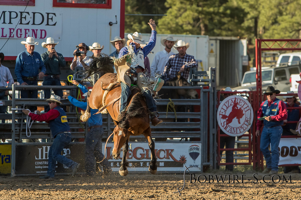 Bareback bronc rider Colemun Harbaugh rides Summit Pro Rodeo's Mo in the second performance of the Elizabeth Stampede on Saturday, June 2, 2018.