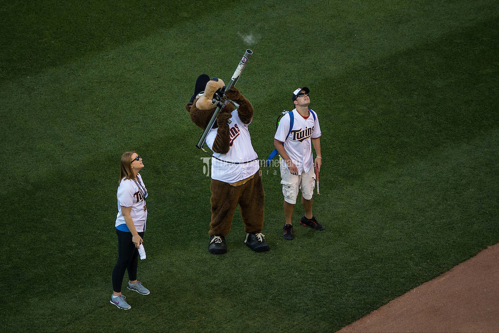 MINNEAPOLIS, MN- JUNE 23: Minnesota Twins mascot TC Bear shoots t-shirts to fans against the Chicago White Sox on June 23, 2015 at Target Field in Minneapolis, Minnesota. The White Sox defeated the Twins 6-2. (Photo by Brace Hemmelgarn) *** Local Caption ***