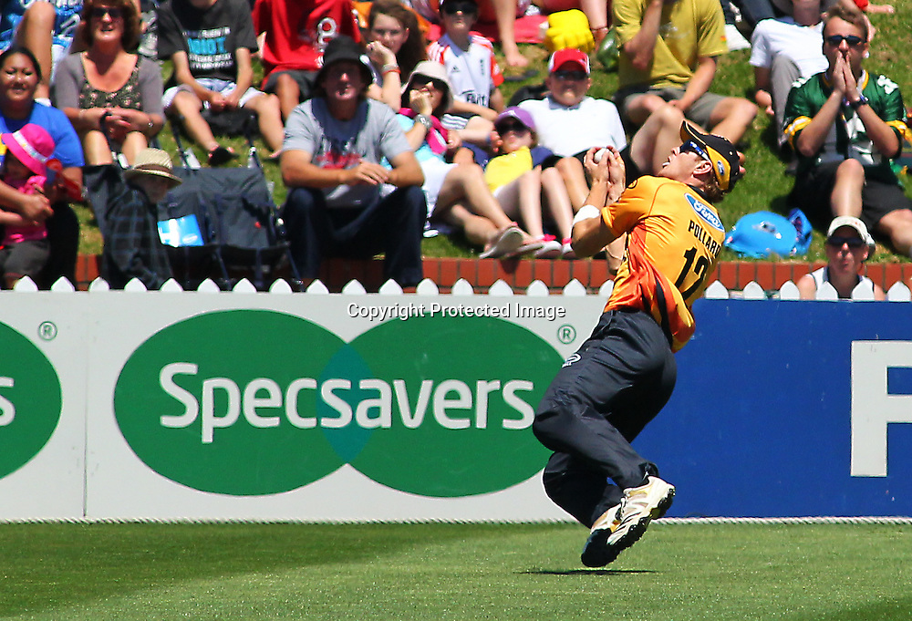 Michael Pollard takes a catch in the deep during their Twenty20 Cricket match - HRV Cup, Wellington Firebirds v Central Stags, 27 December 2011, Hawkins Basin Reserve, Wellington. . PHOTO: Grant Down / photosport.co.nz