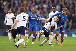 AFC Wimbledon's Lyle Taylor (right) and Tottenham Hotspur's Juan Foyth battle for the ball during the Emirates FA Cup, Third Round match at Wembley Stadium, London.