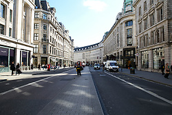 © Licensed to London News Pictures. 16/03/2020. London, UK. Deserted Regents Street as shoppers are avoiding crowded areas amid an increased number of Coronavirus (COVID-19) cases in the UK. 35 coronavirus victims have died and 1,372 have tested positive forthe virusin the UK as of9amon Sunday, 15 March 2020. Photo credit: Dinendra Haria/LNP