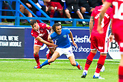 Macclesfield Town defender Miles Welch-Hayes fouled by the opponent  during the EFL Sky Bet League 2 match between Macclesfield Town and Morecambe at Moss Rose, Macclesfield, United Kingdom on 20 August 2019.