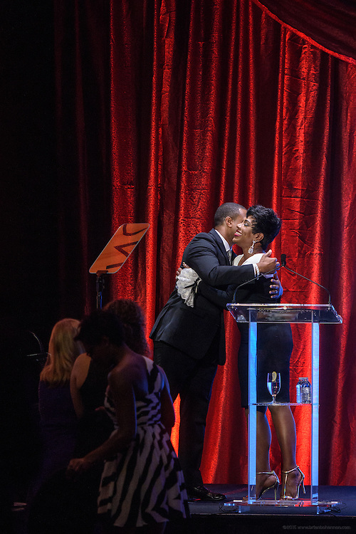 Event host and MSNBC anchor, Craig Melvin, left, embraces Sheryl Lee Ralph, recipient of the Muhammad Ali Humanitarian Award for Global Citizenship after her performance at the fourth annual  Muhammad Ali Humanitarian Awards Saturday, Sept. 17, 2016 at the Marriott Hotel in Louisville, Ky. (Photo by Brian Bohannon for the Muhammad Ali Center)