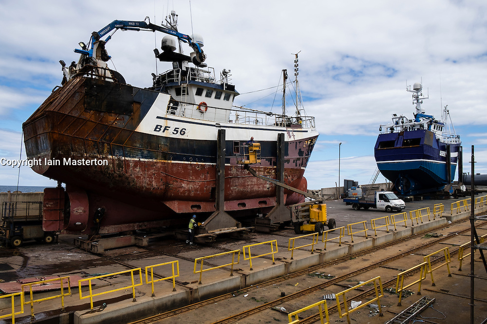 Fishing trawlers under repair at shipyard in Macduff in Aberdeenshire Scotland