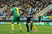 Norwich City defender Sebastien Bassong  gets hold of Newcastle United forward Aleksandar Mitrovic  during the Barclays Premier League match between Newcastle United and Norwich City at St. James's Park, Newcastle, England on 18 October 2015. Photo by Simon Davies.