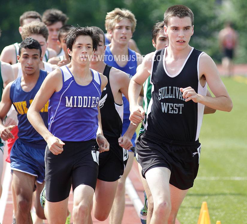 Scott Reed of Sullivan West, at right, leads the field in the 3,200-meter run during the Section 9 track and field state qualifying meet in Middletown on Thursday, May 30, 2013. Middletown's Alex Shodai, left, won the race.