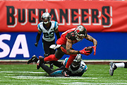 Tampa Bay Buccaneers Wide Receiver Mike Evans (13) takes a tackle during the International Series match between Tampa Bay Buccaneers and Carolina Panthers at Tottenham Hotspur Stadium, London, United Kingdom on 13 October 2019.