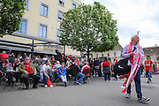 Liverpool fans enjoy drinks in the city centre and scarf seller during the Europa League Final match between Liverpool and Sevilla at St Jakob-Park, Basel, Switzerland on 18 May 2016. Photo by Phil Duncan.