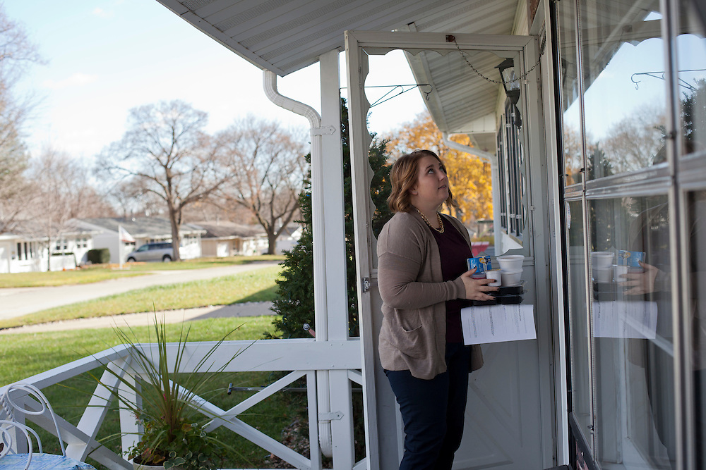 Horizons volunteer coordinator Anna Ronnebaum waits outside the home of a senior Meals on Wheels client in Cedar Rapids, Iowa on Thursday, November 19, 2015. Horizons relies on groups of regular volunteers to deliver meals seven days a week in the Cedar Rapids area. (Rebecca F. Miller/Freelance for The Gazette)