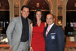 Left to right, ERIC DEARDORFF CEO of Garrard, HANNAH WHITE and DATUK PATRICK LIM World Match Racing Tour Executive Chairman at a reception to unveil the ISAF World Match Racing Tour Championship Trophy at Garrard, 24 Albemarle Street, London W1 on 7th November 2011.