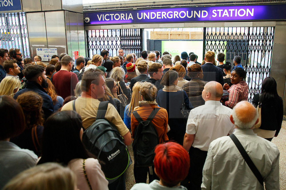 © Licensed to London News Pictures. 08/07/2015. London, UK. Commuters queuing outside Victoria tube station ahead of the Tube strike in the evening rush hour of Monday, July 8, 2015. The strike will be a 27-hour stoppage by about 20,000 Tube staff to shut down the entire London Underground network. Photo credit: Tolga Akmen/LNP