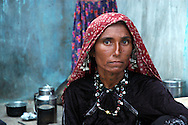 Maldhari woman with ears heavy with silver..Michael Benanav - mbenanav@gmail.com