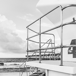 Lifeguard tower four and Gulf Pier black and white photo. Pensacola Beach is on Santa Rosa Island in the Emerald Coast of the Southeastern United States of America. Photo is vertical and high resolution. Copyright ⓒ 2018 Paul Velgos with All Rights Reserved.