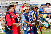 10 SEPTEMBER 2004 - WINDOW ROCK, AZ: Native American veterans of the US military perform a gourd dance during the 58th annual Navajo Nation Fair in Window Rock, AZ. The Navajo Nation Fair is the largest annual event in Window Rock, the capitol of the Navajo Nation, the largest Indian reservation in the US. The Navajo Nation Fair is one of the largest Native American events in the United States and features traditional Navajo events, like fry bread making contests, pow-wows and an all Indian rodeo. Gourd dances originated amongst the Indian tribes in Oklahoma to honor those that served in the US military. They have since spread to almost every tribe in the country and are generally the first dance at a pow-wow.  PHOTO BY JACK KURTZ