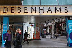 © Licensed to London News Pictures. 10/01/2019. London, UK.  Department store chain Debenhams reports a 5.7% fall in like-for-like sales in the 18 weeks to 5 January 2019. Shoppers outside Debenhams store on Oxford Street.Photo credit: Dinendra Haria/LNP