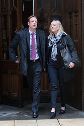 © Licensed to London News Pictures. 27/02/2017. LONDON, UK.  Gabby (Gabrielle) and Florian Kuehn leave Mayor's and City of London court in London after losing the case against their property management company, Victory Place. Gabby and Florian Kuehnn from Limehouse in east London claim they were told their pet dog, a Yorkshire terrier cross, Vinnie could live in their flat when they purchased it, but the management firm, Victory Place has subsequently insisted it has has a blanket no-pets policy. The animal rescue charity, All Dogs Matter are backing the couple and says no-pet rules see thousands of pets dumped each year and the rules are particularly unfair on the elderly and vulnerable who rely on pets for support and companionship. Photo credit: Vickie Flores/LNP