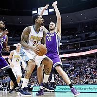 06 March 2017: Denver Nuggets forward Wilson Chandler (21) drives past Sacramento Kings center Kosta Koufos (41) and Sacramento Kings guard Buddy Hield (24) during the Denver Nuggets 108-96 victory over the Sacramento Kings, at the Pepsi Center, Denver, Colorado, USA.