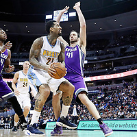 06 March 2017: Denver Nuggets forward Wilson Chandler (21) drives past Sacramento Kings center Kosta Koufos (41) and Sacramento Kings guard Buddy Hield (24) during the Denver Nuggets 108-96 victory over the Sacramento Kings, at the Pepsi Center, Denver, Colorado, USA.