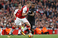Rob Holding of Arsenal (L) grapples with Jordan Ayew of Swansea City's (R) . Premier league match, Arsenal v Swansea city at the Emirates Stadium in London on Saturday 28th October 2017.<br /> pic by Steffan Bowen, Andrew Orchard sports photography.