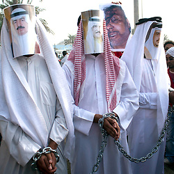 © under license to London News Pictures. 21/02/2011. Men wearing masks featuring government officials stage a mock arrest at Pearl Roundabout in Manama, Bahrain. Photo credit should read Michael Graae/London News Pictures
