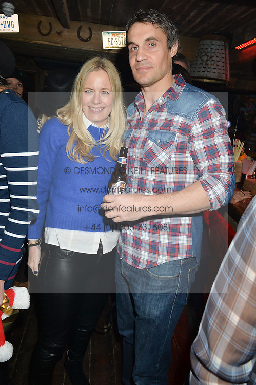 ADAM BIDWELL and ASTRID HARBORD at a party to celebrate the opening of Beaver Lodge, a new bar & club from the Inception Group at 266 Fulham Road, London SW10 on 4th December 2014.