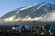 Climbing Kilimanjaro - Porters relax near their tents at the Karanga Valley camp at 4100 meters