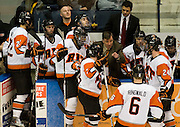 2010/03/19 - RIT head coach Wayne Wilson speaks with players during a timeout. RIT defeated Canisius 4-0 in the Atlantic Hockey semifinal at the Blue Cross Arena in Rochester, N.Y. on March 19th, 2010.