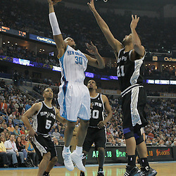 29 March 2009: New Orleans Hornets forward David West (30) shoots over San Antonio Spurs center Tim Duncan (21) during a NBA game between Southwestern Conference rivals the New Orleans Hornets and the San Antonio Spurs at the New Orleans Arena in New Orleans, Louisiana.