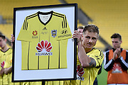 Ben Sigmund of the Phoenix holds a Phoenis shirt after his last game for the Phoenix during the A-League - Wellington Phoenix v Western Sydney football match at Westpac Stadium in Wellington on Sunday the 10 April 2016. Copyright Photo by Marty Melville / www.Photosport.nz