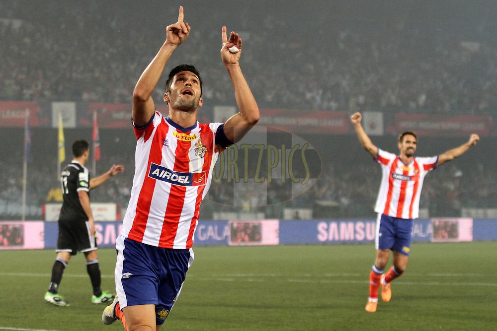 Luis Javier Garcia Sanz of Atletico de Kolkata celebrates his goal against theNorthEast United FC during match 35 of the Hero Indian Super League between Atl&eacute;tico de Kolkata and NorthEast United FC held at the Salt Lake Stadium in Kolkata, West Bengal, India on the 18th November 2014.<br /> <br /> Photo by:  Deepak Malik/ ISL/ SPORTZPICS