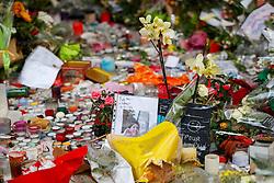 © Licensed to London News Pictures. 17/11/2015. Paris, France. Flowers left outside La Belle Équipe cafe in Paris, France following the Paris terror attacks on Tuesday, 17 November 2015. Photo credit: Tolga Akmen/LNP