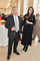 ADRIAN SASSOON and ALEXA GRAY at a party to celebrate the 150th anniversary of Wartski held at The Orangery, Kensington Palace, London, on 19th May 2015.