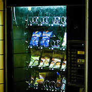 February 11, 2010 - Bronx, NY : A vending machine in John F. Kennedy High School is stocked with Doritos Cool Ranch and Baked Lays potato chips, in addition to nuts, nutrigrain bars, and raisins.