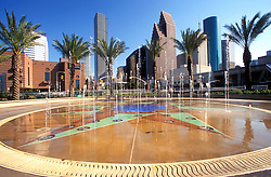 Stock photo of The Downtown Aquarium fountain and the downtown Houston skyline.
