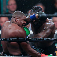 Deontay Wilder (R) lands a hard shot to the head of Luis Ortiz during the WBC Heavyweight Championship boxing match at Barclays Center on Saturday, March 3, 2018 in Brooklyn, New York. Wilder would win the bout by knockout in the tenth round to retain the title and move to 40-0. (Alex Menendez via AP)