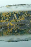 Mist on gold mining tailings pond, Dawson City, Yukon