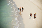 Tourists walking down the beach on Cayo Las Brujas, Cuba on Friday July 18, 2008.
