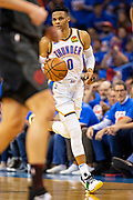 OKLAHOMA CITY, OK - APRIL 21: Russell Westbrook #0 of the Oklahoma City Thunder brings the ball down the court during a game against the Portland Trail Blazers during Round One Game Three of the 2019 NBA Playoffs on April 21, 2019 at Chesapeake Energy Arena in Oklahoma City, Oklahoma  NOTE TO USER: User expressly acknowledges and agrees that, by downloading and or using this photograph, User is consenting to the terms and conditions of the Getty Images License Agreement.  The Trail Blazers defeated the Thunder 111-98.  (Photo by Wesley Hitt/Getty Images) *** Local Caption *** Russell Westbrook