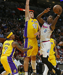 March 1, 2018 - Miami, FL, USA - The Miami Heat's Josh Richardson, right, goes to the basket against the Los Angeles Lakers' Ivica Zubac (40) and Isaiah Thomas (7) during the second quarter at the AmericanAirlines Arena in Miami on Thursday, March 1, 2018. The Lakers won, 131-113. (Credit Image: © David Santiago/TNS via ZUMA Wire)