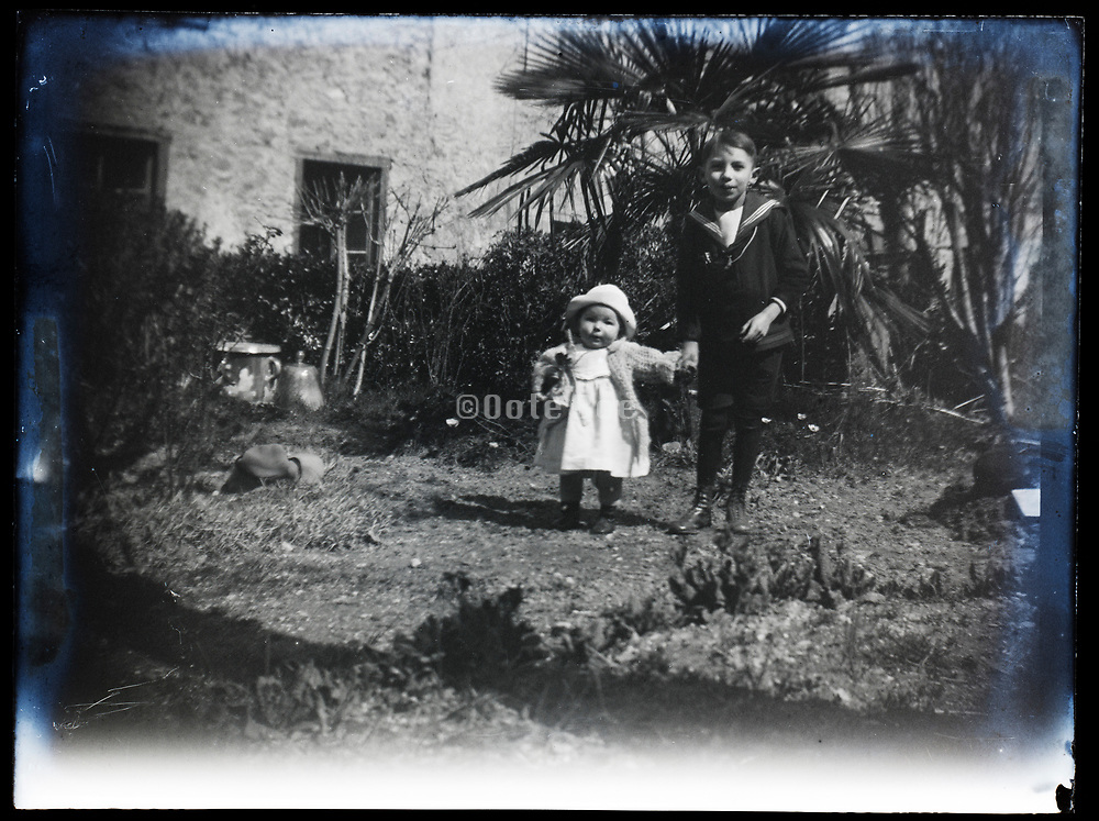 boy with little girl toddler sister France 1921