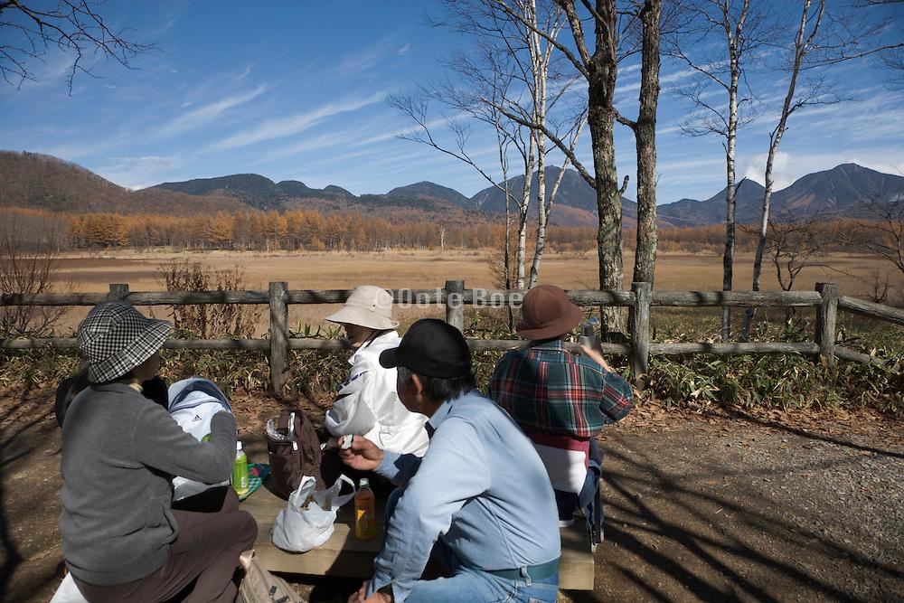 group of elderly people picnicking Okunikko mountain range Japan