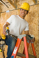 Construction worker on ladder, portrait