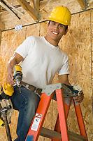 Construction worker on ladder, portrait