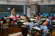 Children learning in class at Instituto Cristóvan School in São Paulo, Brazil. Missão Paz, an organisation that works in partnershp with C&A Foundation, pays for children to attend the school so that parents who are working in the textile industry can get on and work without worrying about looking after their childen at the same time.