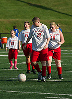 Austin Hancom drives the ball down the field during LHS Unified Soccer with Winnisquam Monday afternoon.  (Karen Bobotas/for the Laconia Daily Sun)