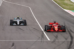 May 13, 2018 - Barcelona, Catalonia, Spain - 05 Sebastian Vettel from Germany with Scuderia Ferrari SF71H overtaking 77 Valtteri Bottas from Finland Mercedes W09 Hybrid EQ Power+ team Mercedes GP  during the Spanish Formula One Grand Prix at Circuit de Catalunya on May 13, 2018 in Montmelo, Spain. (Credit Image: © Xavier Bonilla/NurPhoto via ZUMA Press)