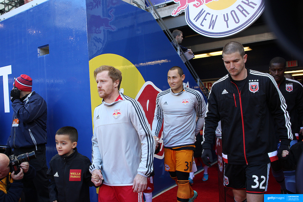 Dax McCarty, New York Red Bulls, leads his team onto the field during the New York Red Bulls Vs D.C. United Major League Soccer regular season match at Red Bull Arena, Harrison, New Jersey. USA. 22nd March 2015. Photo Tim Clayton