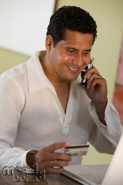 Man Making Purchase Using Cell Phone