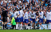 Photo. Glyn Thomas. Digitalsport<br /> Manchester City v Everton. <br /> Barclays Premiership. 11/09/2004.<br /> Referee Steve Bennett (L) shows Everton's Tim Cahill the red card after he was shown his second yellow card for over-celebrating scoring for his side.