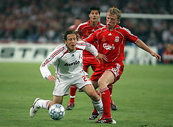Athens, Greece - Wednesday, May 23, 2007: Liverpool's Dirk Kuyt and AC Milan's Massimo Ambrosini during the UEFA Champions League Final at the OACA Spyro Louis Olympic Stadium. (Pic by Chris Ratcliffe/Propaganda)